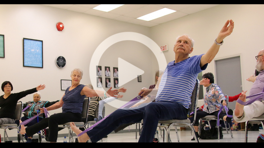 Older adults in chair yoga class